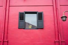 Red wall window Stock Photo