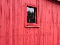 Red wall with window in a Frontier town Royalty Free Stock Photo