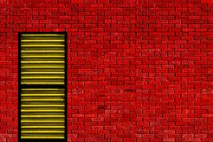 Red wall yellow door Stock Photo