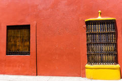 Red Wall and Yellow Window Stock Image
