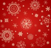 Red wallaper for winter holiday with lacy golden baubles Stock Photo