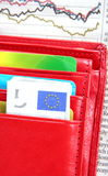 Red wallet and down diagram Royalty Free Stock Photo