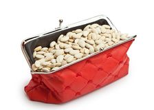 Red wallet filled with white beans. Outdoor red purse filled with beans white beans, isolated on white background Stock Images