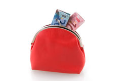 Red wallet with money. Isolated on white background royalty free stock photos