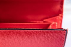Red wallet opened pockets closeup - Image. Red wallet opened pockets closeup, wallet with the pockets - Image royalty free stock photography