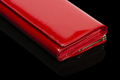 Red wallet. Shiny female purse on a black background Royalty Free Stock Photo