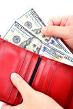 Red wallet with US dollars in the hands Royalty Free Stock Photos