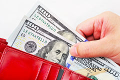 Red wallet with US dollars in the hands Stock Photo