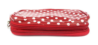 Red wallet with white spots royalty free stock photo