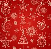 Red wallpaper for winter holiday with hanging golden baubles Royalty Free Stock Photo