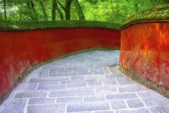 Red walls and stairs in traditional temple Royalty Free Stock Photography