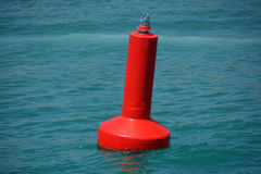 Red warning buoy Stock Photography