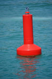 Red warning buoy Stock Photo