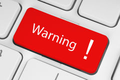 Red warning button. On the keyboard Stock Photo