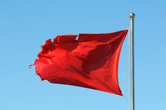 Red Warning Flag Stock Photography