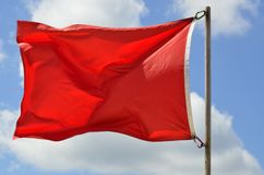 Red warning flag Royalty Free Stock Photography
