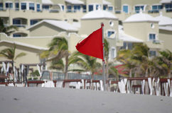 Red warning flag. On the beach, Cancun, Mexico stock images