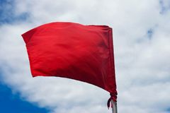 Red warning flag at the beach Stock Image