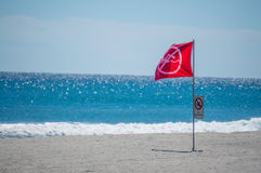 Red warning flag on a Florida beach Stock Image
