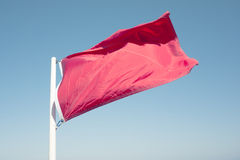 Red Warning Flag. With Retro effect applied Stock Photos