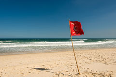Red Warning Flag Stock Image