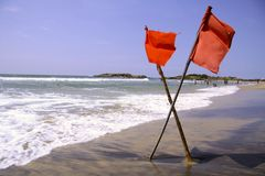 Red warning flags at beach Stock Photo