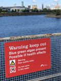 Red warning keep out sign. At Birkenhead Docks, Wirral  because of blue green algae Stock Photo