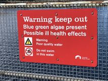 Red warning keep out sign. At Birkenhead Docks, Wirral  because of blue green algae Stock Images