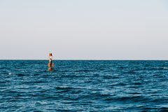 Red Warning Light Floating In Ocean Royalty Free Stock Photo