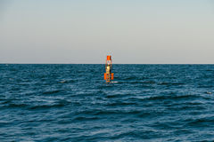 Red Warning Light Floating In Ocean Stock Photography