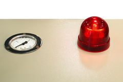 The red warning light and the instrument pointer. Stock Photography