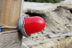 Red warning light which enclosing the ditch, where the repair of water pipes stock photos