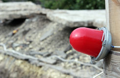 Red warning light which enclosing the ditch, where the repair of water pipes royalty free stock photos
