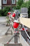 Red warning light which enclosing the ditch, where the repair of water pipes. royalty free stock photos