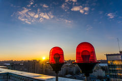 Red warning lights on the roof of high-rise building. Red aircraft warning lights on the roof of high-rise building Royalty Free Stock Photography