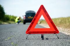 Red Warning Triangle. With a broken down car royalty free stock photography