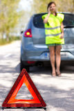 Red warning triangle. With a broken down car Royalty Free Stock Photo