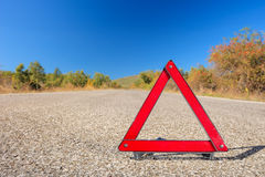 Red warning triangle on a road Stock Photos