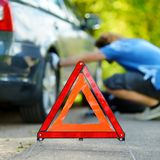 Red warning triangle sign on the road Stock Photography