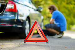 Red warning triangle sign on the road Stock Photos