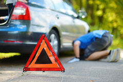 Red warning triangle sign on the road Stock Photo