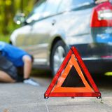 Red warning triangle sign on the road Royalty Free Stock Images