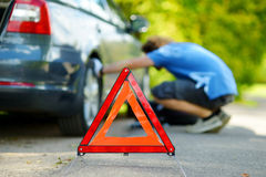 Red warning triangle sign on the road Stock Images