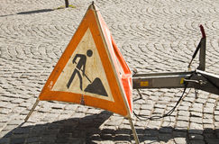 Red warning triangle with works ahead sign Royalty Free Stock Photography