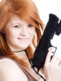 Red warrior girl holding gun. Closeup of red warrior girl holding gun Royalty Free Stock Photo