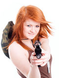 Red warrior girl holding gun over white Stock Images