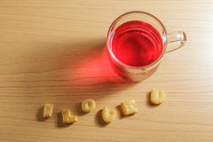 Red water and biscuits Stock Photos