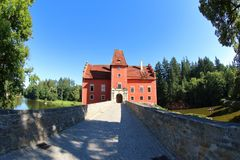 Cervena Lhota, Czech Republic. The red water castle, Cervena Lhota, and its stone bridge, South Bohemia, Czech Republic. A picturesque Renaissance building royalty free stock photo