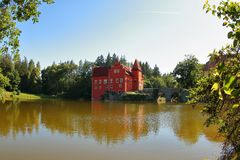 Cervena Lhota, Czech Republic. The red water castle, Cervena Lhota, South Bohemia, Czech Republic. A picturesque Renaissance building surrounded by water royalty free stock photo