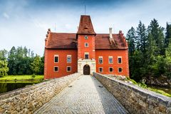 Cervena Lhota - the red, water chateau in the the Czech republic. The red, water chateau in the the Czech republic - Cervena Lhota royalty free stock photo